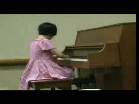 Four-fingered pianist wows Edina, MN, students