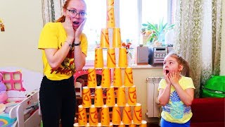 Ksyusha and Nastya Play with COLORED Cups for Kids