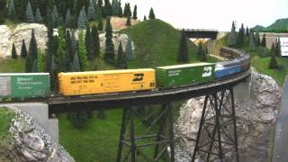 BN HO Scale Layout Model Railroad Train Video - HD JAN 2011(Follow a Burlington Northern manifest train on Tim Dickinson's HO Scale model railroad empire. Through rail yards, long tunnels, curved trestles and more, hear ..., 2011-01-12T22:33:34.000Z)