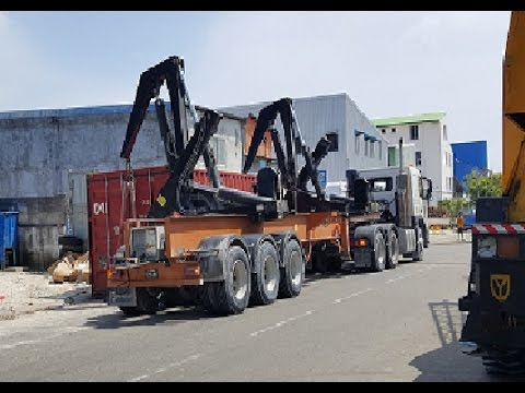 loading container to a side container loading truck trailer