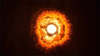 Top view of a beautiful burning Diya decorated with marigold garlands - Diwali decorations