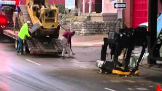 Backhoe torn in two in Covington underpass accident
