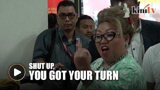 Siti Kassim flicks the bird at audience member during Hudud forum