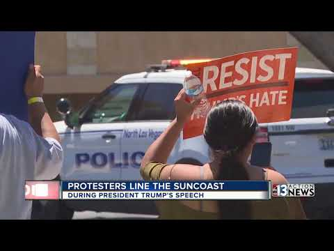 Protesters rally outside the Suncoast as President Trump arrives in Las Vegas