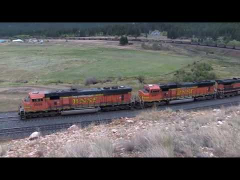 BNSF FREIGHT TRAIN WITH COAL CLIMBING THE HILL [drone view]