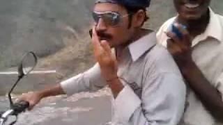 pakistani boy with girl bike villing