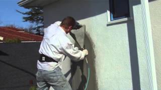 spray plaster with a hand hopper