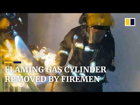 Heroic firemen remove flaming gas cylinder from a residential building in China