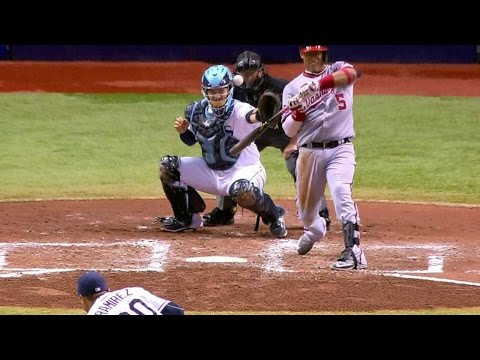 ball-hits-escobar,-catcher-and-umpire
