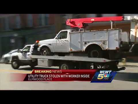 Utility truck stolen with public works employee in its bucket