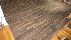 Wood look plank tile installation time lapse on Schluter Ditra with T-Lock™