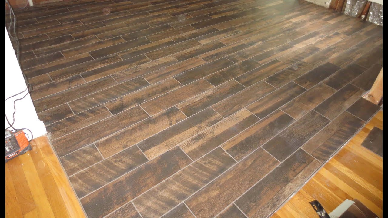 wood look plank tile installation time lapse on schluter ditra with t lock