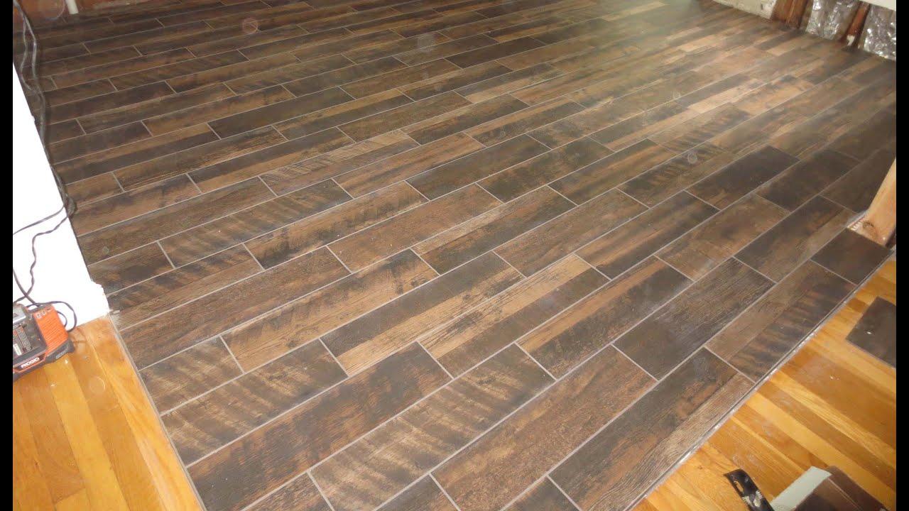 Wood look plank tile installation time lapse on Schluter ...