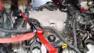 Cómo remover bujías traseras en Buick Rendezvous
