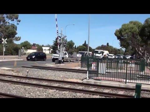 Traffic bottleneck Kings Road Parafield Rail Level Crossing in Greater Adelaide Video Dec 2015