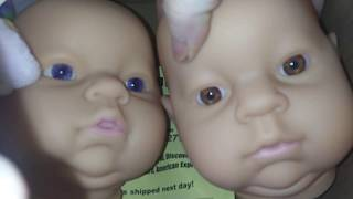 Low cost reborn baby head for cuddle body