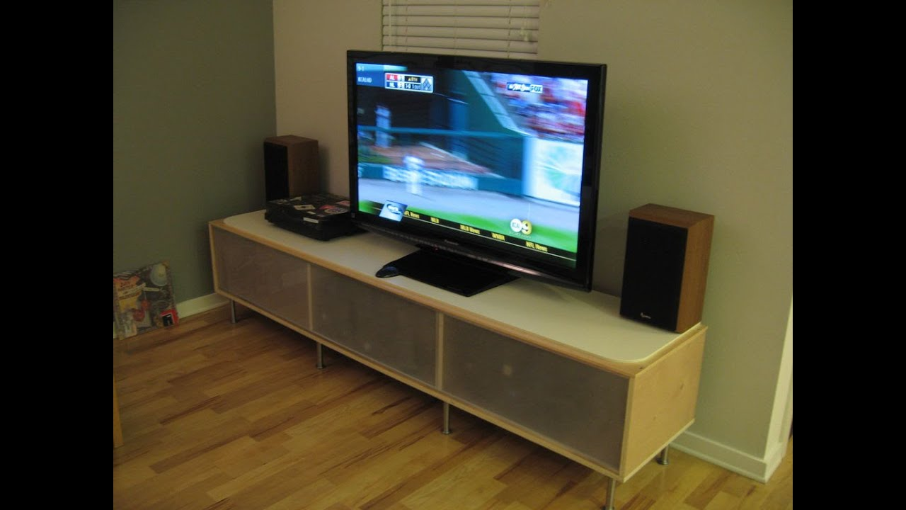 how to put a tv on a tv stand