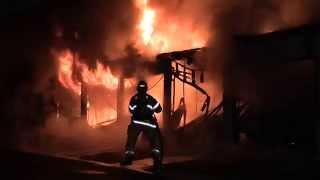 RAGING APARTMENT  GARAGE FIRE