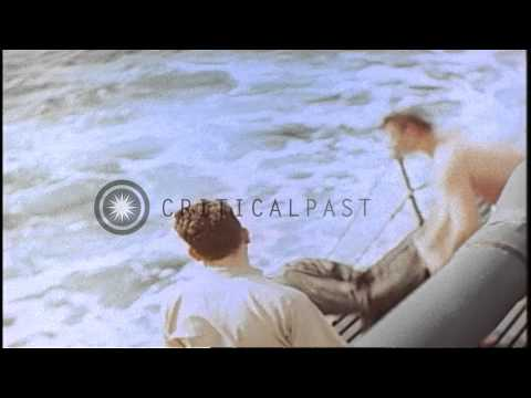 Crew members aboard USS Springer recover a dead Japanese pilot in the Pacific Oce...HD Stock Footage