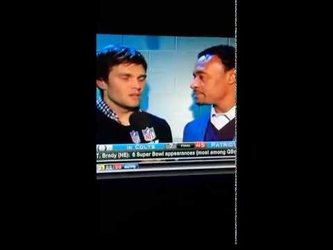 Former Patriots teammate Willie McGinest interviews Tom Brady after officially making his 6th SB