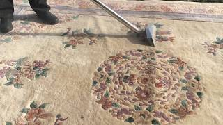 How to dust a rug