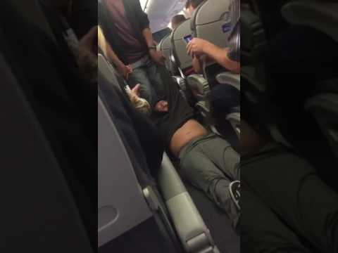 Authorities Haul Passenger Off Overbooked United Flight