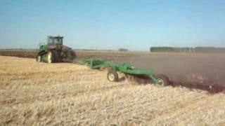Moldboard plowing wheat stubble with 16 bottom plow