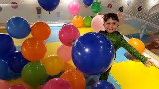 Zack plays with Balloons at the Indoor playground for Kids