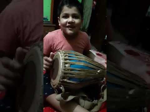 Kid playing dhol