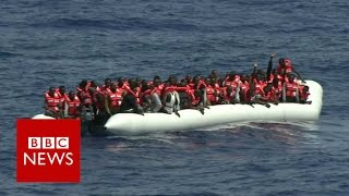 Migrant crisis: 'A huddle of humanity' pulled from open seas - BBC News