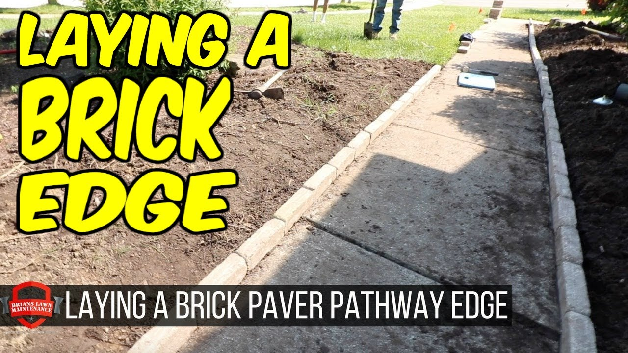 Laying A Brick Paver Edge On Pathway Landscaping Job The Weekend