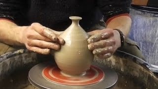 Making A Simple Clay Pottery Hanging Bird Feeder On The Wheel