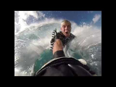 Bodysurfing solid south swell on outer reef.