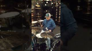 Kid playing drums at music store