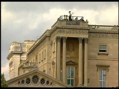 Brian May on the roof of Buckingham Palace