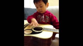 Dylan on Guitar playing Tien Mi Mi