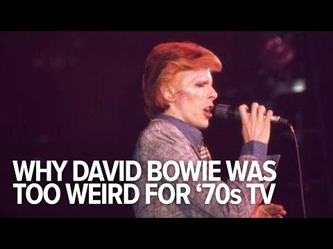 David Bowie Was Too Weird For '70s TV: David Bowie's perpetual stylistic reinvention (don't call him a chameleon) became a standard many pop stars would come to adopt. To put his visionary genius in perspective, we assembled a reel of '70s and '80s TV clips, in which Bowie's shape-shifting ways were marveled at, questioned, and explained by the man himself.  Read more: http://gawker.com/david-bowie-was-too-weird-for-70s-tv-1752307016  Edited by Julian Muller Production Assistant: Erika Audie  Today's gossip is tomorrow's news. https://gawker.com