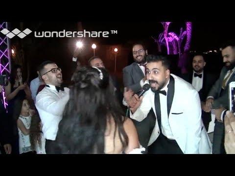 عريس فاجآ عروسته و المعازيم في حفل الزفاف بآغنية تولع الفرح ' افرح يلا '