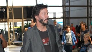 Keanu Reeves Takes Tons Of Photos For Fans On His 51st Birthday