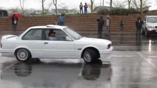 BMWs playing in the wet. E30 325iS, E39 M5, F23-2SERIES