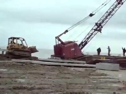 Crane falls off barge