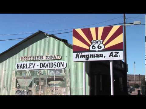 Route 66 Sign at Kingman Arizona and Harley Davidson Motorcycle Sign near Highway and Mojave Desert
