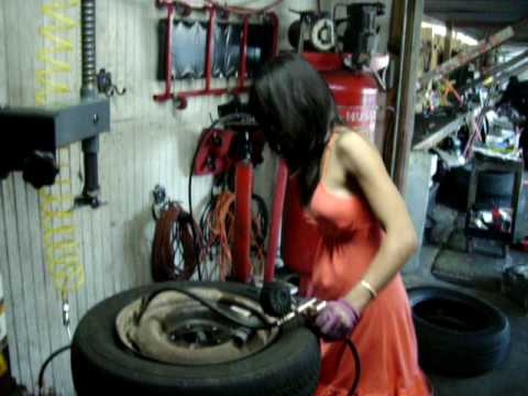 Asian Lady Who Changes Tires In A Dress