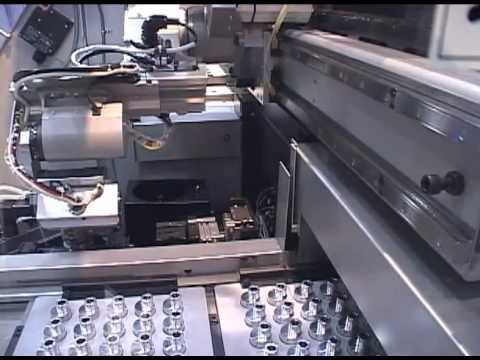 DENSO Robotics - Internally installed robot tends CNC machine