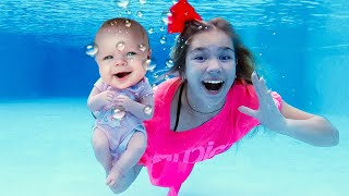 Maggie is swimming with little Naomi