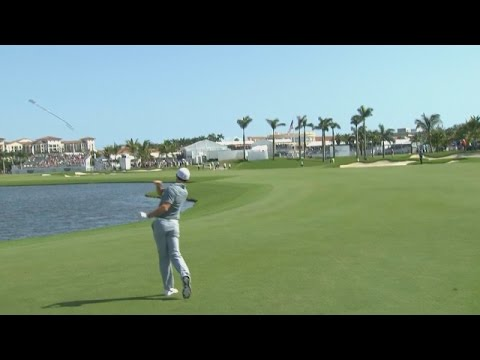 rory mcilroy s approach into water and club toss at the cadillac