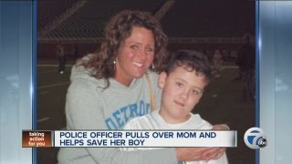 Police officer pulls over mom, helps to save boy