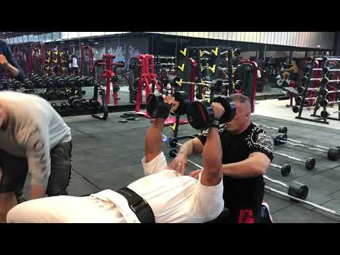 Chest triple-drop superset with Lu Chen Hui.