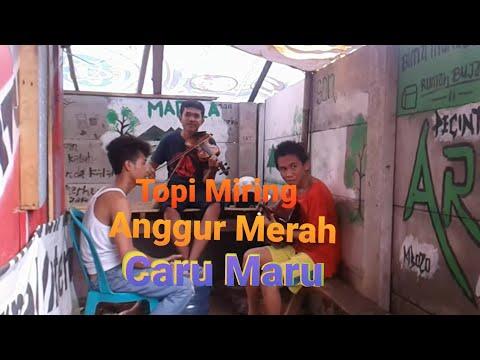 TOPI MIRING ANGGUR MERAH