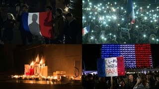 World sings, lights up in solidarity with wounded France